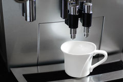 Coffee machine and a coffee cup Stock Photography
