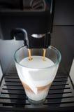 Coffee machine and coffee glass Royalty Free Stock Photo