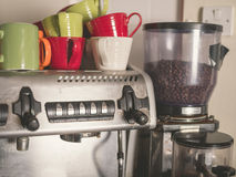 Coffee machine and colorful cups Stock Photos