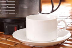 Coffee machine and cup Stock Photography
