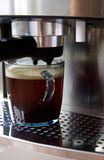 Coffee machine and a cup of coffee Royalty Free Stock Photos