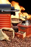 Coffee machine with cup  of espresso near fireplace Stock Photography