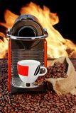 Coffee machine with cup  of espresso near fireplace Royalty Free Stock Photography