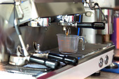 Coffee. Machine cup Measure of . Making espresso with  machine, shallow focus Stock Photography