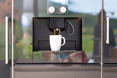 Coffee machine in design domestic kitchen Stock Photography