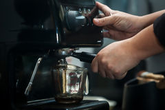 Coffee machine. Espresso machine with hand in processing coffee drink Royalty Free Stock Photo
