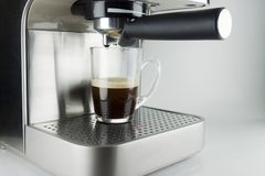 Coffee machine with glass cup Stock Photos
