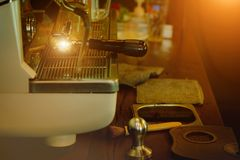 Coffee machine with gold light effect stock image