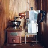 Coffee machine. And coffee grinder in wooden cabinet stock images