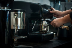 Coffee machine with hand in processing. Espresso machine with hand in processing coffee drink Royalty Free Stock Photography
