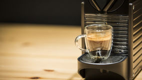 A coffee machine has just made a coffee. A coffee machine has just made an espresso coffee Stock Photography