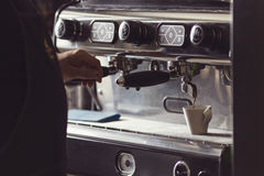 Coffee machine makes one cup hot coffee Royalty Free Stock Images