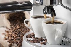 Coffee machine. Makes two coffee with coffee beans on background Royalty Free Stock Photos