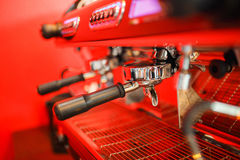 Coffee machine makes two coffee on red background. Coffee machine makes coffee on red background Royalty Free Stock Photography