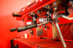 Coffee machine makes two coffee on red background. Coffee machine makes coffee on red background Stock Image
