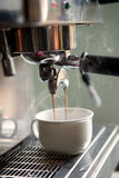 Coffee machine is making a cup of coffee Stock Photo