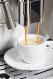 Coffee machine making espresso. Coffee machine making a hot espresso cup royalty free stock photos