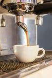 Coffee machine making espresso . Royalty Free Stock Photo