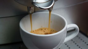 Coffee Machine Making Espresso into a Cap Royalty Free Stock Images