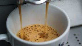 Coffee Machine Making Espresso into a Cap Royalty Free Stock Photos