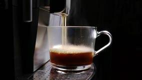 Coffee Machine Making Espresso into a Transparent Cap stock footage