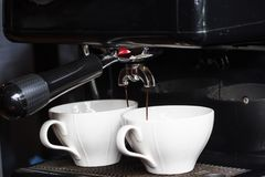 Coffee machine making two cup of fresh espresso background. royalty free stock images