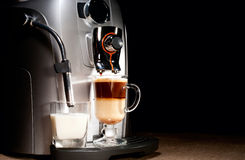 Coffee machine with milk glass Royalty Free Stock Photos