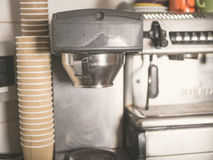 Coffee machine and paper cups Royalty Free Stock Photos