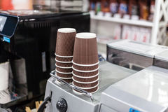 Coffee machine with paper cups. Stock Photo