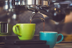 Coffee machine pouring coffee royalty free stock image