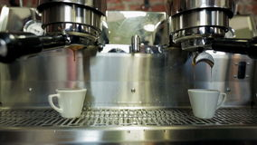 Coffee machine pouring coffee in small cups stock video footage