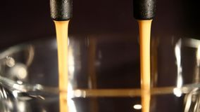Coffee machine pouring espresso in cup extremely close-up Stock Photography