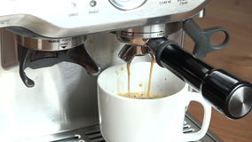 Coffee machine pouring espresso in cup stock video footage