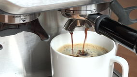 Coffee machine pouring espresso in cup stock video