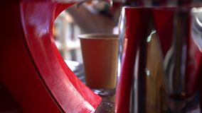 Coffee machine pouring coffee in to the paper cups. stock video footage