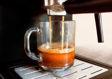 Coffee machine pours coffee. Into the cup royalty free stock photography