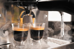 Coffee machine preparing cup of coffee Stock Photography