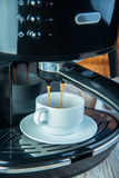 Coffee machine preparing cup of coffee Stock Image