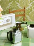 Coffee machine retro kitchen green tablecloth Royalty Free Stock Images