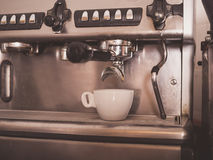 Coffee machine and a small white cup Royalty Free Stock Photo