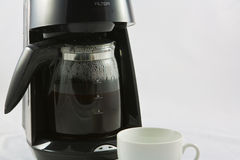 Coffee machine and whiter cup Royalty Free Stock Image