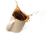 Coffee mag. Splash in a coffee cup Royalty Free Stock Image