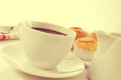 Coffee and magdalenas, typical spanish plain muffins, with a fil Royalty Free Stock Photos