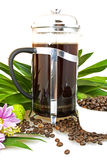 Coffee maker. Made of glass with metallic lid, decorated with flowers, leaves and coffee beans Royalty Free Stock Images