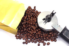 Coffee maker. And gold bag Stock Image