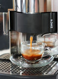 Coffee maker. Coffee machine with cup of fresh coffee Royalty Free Stock Photo