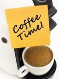 Coffee maker with adhesive note. On white Stock Image