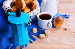 Coffee maker. Blue color on the background of croissants and utensils for coffee Royalty Free Stock Images