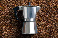 Coffee maker on coffee beans Royalty Free Stock Image