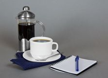 Coffee maker, cup and note book Royalty Free Stock Photography